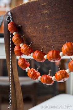 String miniature pumpkins together with beads to create a unique garland for your Halloween or Thanksgiving decor!