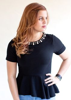 Darling Jessica Black Peplum Top.  I can see this  with pencil skirt for office/daytime and with satin tea length skirt for evening.