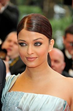 Aishwarya Rai Ponytail - Aishwarya Rai looked flawless at the 2009 Cannes Film Festival with her dark locks tightly swept back into a low ponytail.