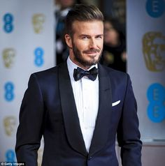 Beckham was wearing a navy blue suit and black lapel for the prestigious British awards ceremony