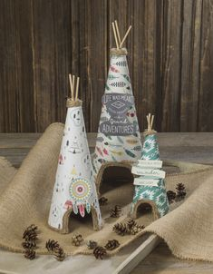 Www.craftwarehouse.com blog, paper cone teepee centerpieces, love the feather papers!