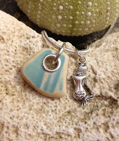 Not a DIY project, but a beautiful genuine made-in-Maine one-of-a-kind piece!  Sea glass jewelry- sea glass pottery set in sterling silver. With double sided mermaid charm.