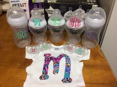 Great baby gift idea. Monogrammed onesie using a Lily Pulitzer inspired HTV, monogrammed bottles and pacifiers using Oracal 651 vinyl.