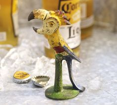 Add a whimsical touch to your home bar collection with our sculptural parrot bottle opener. It's crafted of iron with painted details.