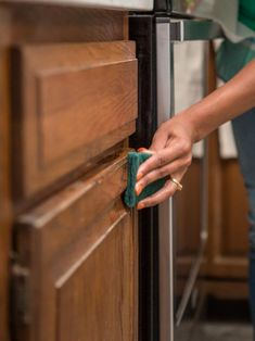 Give your old cabinets a makeover and change the entire look of your kitchen with just a fresh coat of paint.
