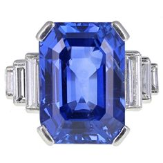 Art Deco Ceylon No Heat 16.73 Carat Sapphire Diamond Ring. An exquisite and rampant Art Deco ring featuring and emerald-cut Ceylon sapphire, flanked by stepped baguette cut diamonds on each side. Mounted in platinum and 18 carat white gold and accompanied by an SSEF certificate stating that the sapphire has been spared any form of heat treatment and weighs 16.731 carats. c 1920s