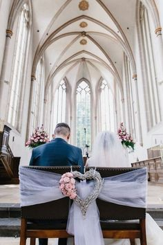 The bride and groom& chairs in the church are covered with tulle and . - Harvey Clark The bride and groom& chairs in the church are covered with tulle and . Wedding Pews, Church Wedding Decorations, Wedding Chairs, Diy Wedding, Wedding Church, Wedding Flowers, Fall Wedding, Rustic Wedding, Inspiration