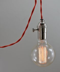 $85 extra large round filament bulb, red wire, and  chrome socket, easy access turn key, long cord and plug. hang it from the ceiling or roll it up and hang it on the wall. UL rated, chrome socket. It comes with 10 feet of reproduction, radiant-red, rayon twist wire, plug on the end. Edison filament globe bulb shown is included.