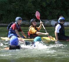 Kids learning to paddle at Kids Kayak Camps