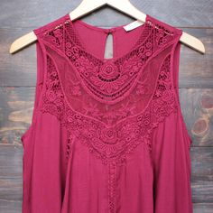 A cute oversized flowy wine/burgundy colored bohemian lace dress. Soft burgundy toned sheer yoke upper lace adorns this darling flirty vintage style dress. - 100% rayon - hand wash cold, lay flat to d
