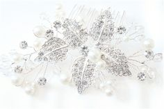 CAD$39.00 - This gorgeous bridal hair comb made with vines of rhinestone leaves gorgious pearls and clear crystals, hand wired together in a beautiful pattern would make any bride sparkle on her big day.  beautiful bridal Hair pieces, for amazing prices check out our website www.karmabridal.com
