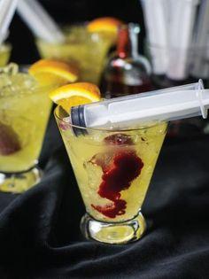 BLOODY ORANGE COCKTAIL* (serves 4)  ~4 oz Vodka  ~2 oz Licor43 (a spiced citrus liqueur) ~8 oz Orangina (or 1:3 Orange Juice to Club Soda) ~3 oz Raspberry Syrup*  ~1 Orange >Plastic Syringes