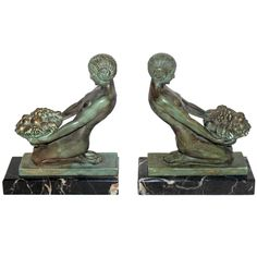 Pair of French Art Deco Figural Bookends by Max Leverrier | From a unique collection of antique and modern bookends at https://www.1stdibs.com/furniture/more-furniture-collectibles/bookends/