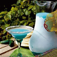Blue Margaritas!  1 (10-ounce) can frozen margarita mix 3/4 cup tequila 1/4 cup blue curaçao liqueur 2 tablespoons lime juice!