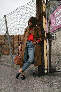 Nisi is wearing: Mango Trenchcoat, Red jumper, Gucci Princetown slipper, Denim mom jeans, Loewe Puzzle bag - teetharejade.com