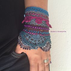 This one of a kind beaded crochet cuff is made of best quality shiny yarns and diffrent kinds of beads. Has flower details and ruffled lace