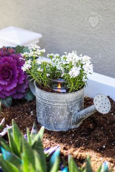 Watering Can Centerpiece - how to make a centerpiece using a watering can, flowers, and a candle. This can be used as garden decor or on top of a table as part of a gorgeous tablescape! Garden Crafts, Garden Projects, Garden Art, Garden Tools, Garden Design, Diy Projects, Project Ideas, Watering Can Centerpieces, Decorative Garden Fencing