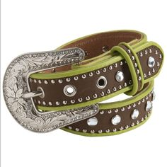 Nocona Rhinestone Stud Leather Belt (For Girls) Your little cowgal's love for bling is oh-so true, so why not nurture it? Nocona's rhinestone stud belt is a funky-feminine eye catcher with neon trim, silvery studs and big, faceted rhinestones to add ample sparkle.  Matte leather strap  Silver studs and faceted rhinestone studs  Contrast piping trim  Rhinestone-encrusted buckle Nocona Accessories Belts