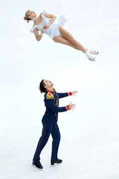 Tatiana Volosozhar and Maxim Trankov of Russia compete in the Figure Skating Pairs Short Program during the Sochi 2014 Winter Olympics at Ic...