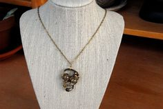 Gold and Gun Metal Bronze Wire Wrapped Skull Necklace by MummyLust, $45.00