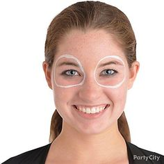 Step 1: Draw two white circles around your eyes with grease paint, a sponge or a brush!