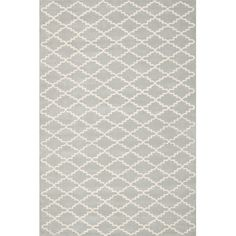 Stylishly anchor your living room or master suite with this lovely hand-tufted wool rug, showcasing a timeless trellis motif in grey and ivory.