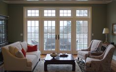 Beautiful, open living room with large French doors with transoms and sidelights. Interior Pocket Doors, Interior Double French Doors, Solid Interior Doors, Interior Railings, Interior Doors For Sale, Internal French Doors, French Doors Patio, Double Doors, White Wooden Doors