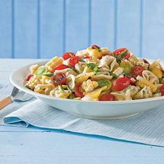 Tortellini-and-Tomato Salad - Great make-ahead salad. Is good for a simple summer dinner or to bring to a pitch in. Can be left out for a few hours without being a health hazard.