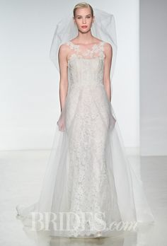 Brides.com: . Trend: Cool Tulle Skirts. Sleeveless corded lace and tulle sheath wedding dress with an illusion high neckline, Amsale