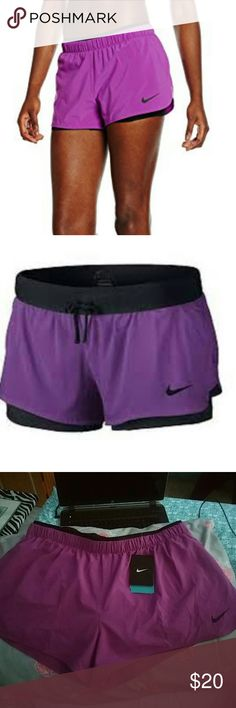 Nwt nike 2 in 1 shorts This is a new pair of Nike 2 and 1 shorts this is a violet and black pair of size extra large Nike shorts Nike Shorts