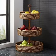 basket and crate - Shop Artesia Honey Fruit Basket. Handcrafted of rattan, the Artesia . Kitchen Items, Home Decor Kitchen, Kitchen Design, Tiered Fruit Basket, Cane Baskets, Fruit Holder, Fruit Storage, Cane Furniture, Bamboo Crafts