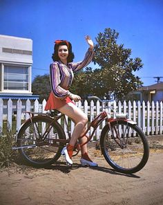 Ann Miller on her bicycle, 1946