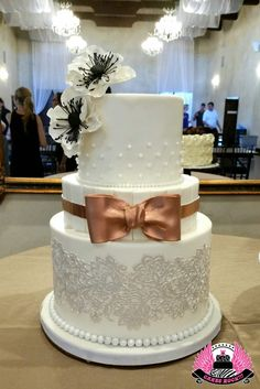 Lovely white on white cake with rose gold/copper accent bow & sugar anemones, Cakes ROCK!!! Austin & Dripping Springs, TX