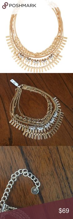 NWT Gold and Crystal Multi-strand Necklace Beautiful and interesting Necklace with multiple gold chains and crystals. Brand new with tags. Jewelry Necklaces