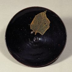 From Our Collection The Museum of Oriental Ceramics,Osaka. Important Cultural Property Tenmoku Glaze with Leaf Design      Acc. No. 10672     Southern Song Dynasty 12th Century     d.14.7cm     Gift of SUMITOMO Group the ATAKA Collection