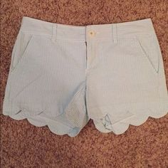 Lilly Pulitzer Buttercup Seersucker Shorts pale blue LP buttercup seersucker shorts, scalloped edges, excellent pre-owned condition-- button is coming loose as shown in photo-- size 4, I do have the tag for authenticity purposes :) willing to negotiate price--accepting all offers via the offer button Lilly Pulitzer Shorts