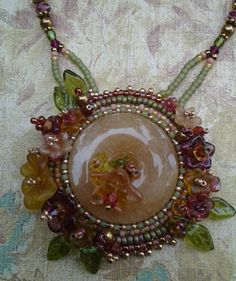 Made by Kiowa Rose Beads Kiowarose.com or kiowarosebeads.etsy.com  bead embroidered floral necklace-hand carved by KiowaRoseBeads