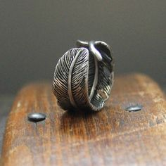 Feather Ring.. i want this... too bad its 52 dollars..