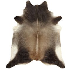 Brazilian Cowhide Rug Gris Dark -This rug was the very first product we bought when we first opened our store!  We traveled eight hours to see it in person, and a photo does not do it justice... Its colors are dark grey with light brown and cream undertones. All of our hides come from Brazil and are of exceptional quality. This rug is large, approximately 6 x 7.5'