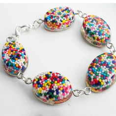 CANDY SPRINKLES BRACELET by Virginia Andersen - Such a simple, fun technique!  Any dry candy can be cast in Little Windows Brilliant Resin and molds.  For more of Virginia's creations, visit her Etsy shop:  EnchantedWishingWell