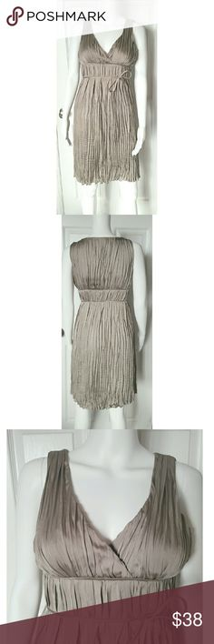 "Banana Republic silvery taupe pleated dress Beautiful Goddess styled dress in very good condition. Only flaws I noticed were some very tiny runs mostly on the left breast (see photo 4) they are so small they are not noticeable. Dress appears to run a size larger than labeled it is labeled a 0. It would possibly even work for a 4 but I'm not 100% sure. It fit very snugly on my mannequin which is a 4. Pit to pit laying flat across chest is approx 16"", waist is  14"" layong flat and shoulder to…"