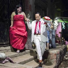 Melad moves with his bride Amal before their engagement party at Manshiet Nasser district, Cairo July 2014