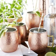 Legend has it the Moscow Mule was invented in the early 1940s, when three gentleman in a bar wondered how the combination of ginger beer, vodka and lime juice would taste. It was good then, and it's good now. It's even better served traditionally in our handcrafted, copper-plated stainless steel mug with a brass handle. This set includes four Moscow Mule Mugs.