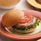 Awesome turkey burgers! You will need to make a few small adjustments to this recipe...reduce the amount of poultry seasoning and breadcrumbs to 1/2 of what the recipe calls for. Use fresh garlic vs. garlic powder and saute the garlic with the onions. You can also substitute the soy sauce for teriyaki sauce if you'd like..top w/ your favorite cheese, condiments and whole wheat bun. So good!!