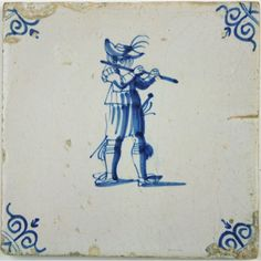 Seventeenth century Dutch Delft tile with a musician playing a baroque flute.