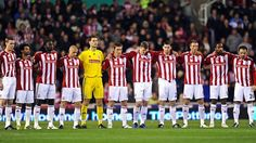Stoke City players observe a minute's silence for Remembrance Day before the match against Liverpool.