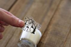 Tape Transfer as Glass Cling. DIY glass clings. You need heat based images (photocopy/ laser print. Inkjet will NOT work). Apply tape. Soak in water. Rub off paper. Blow dry back. Voila. Clings are reusable so you can make new ones for every theme! # parties # decoration # halloween