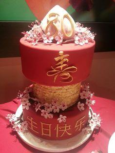 Chinese 80th birthday cake. Longevity,  cherry blossoms,  red, gold, heaven's peach, frills.