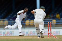 est Indies bowler Kemar Roach (L) celebrates the wicket of Australian batsman Shane Watson (R) during the fourth day of the second-of-three Test matches between Australia and West Indies April 18, 2012 at Queen's Park Oval in Port of Spain, Trinidad.