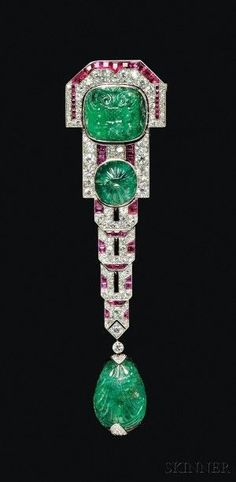 Fine French Art Deco Carved Emerald, Ruby, and Diamond Pendant Brooch, all within a hinged platinum mount, signed Chaumet et Cie